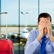 Businessman Stressed about flight delay